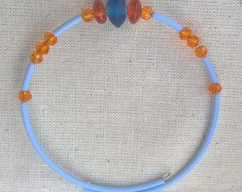 Blue and orange memory wire bracelet with chakri glass and crystal beads