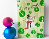 Funny anti christmas card. Christmas stinks. Cheeky snowman and brussel sprout festive card, non traditional