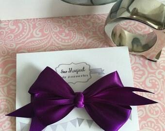 Headband with Large Purple Bow