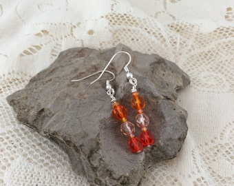 Orange dangly earrings