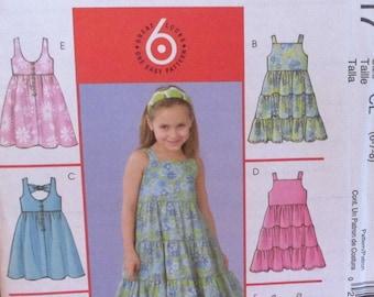 McCall's pattern, girls dresses, 6 variatios, shoulder straps, V-neck back, layered ruffle skirt, size 2, 3, 4, 5