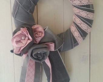 Decoration or door wreath made of grey jeans with pink lace