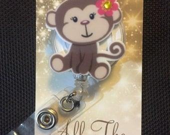 Brown monkey retractable ID badge/reel