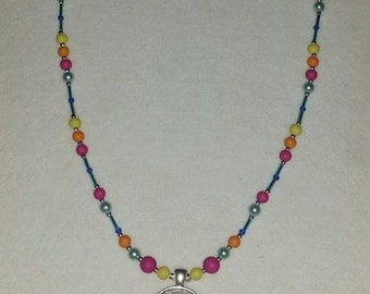 Sun and Moon pendant with bright beaded necklace.