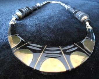 That old black magic.......Vintage tribal bib necklace