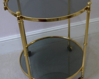 Hollywood Regency Gold metal drinks trolley with tinted glass - Maison Jansen Style