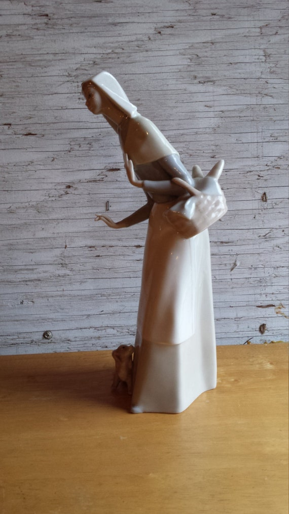 LLadro Shepardess #1034 carrying a loaf of bread and with her little dog.