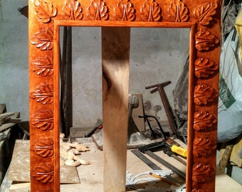 The wooden frame with carvings