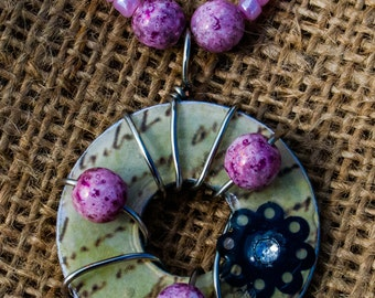 Wire wrapped washer necklace with pink glass beads
