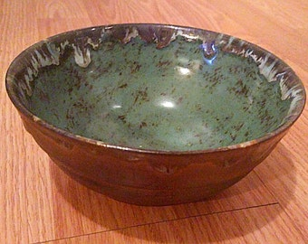 Spotted teal ceramic bowl