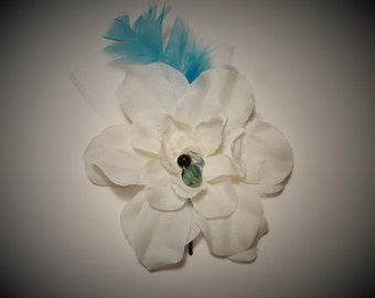 Big white flower with hand sewn beads,feather and tulle