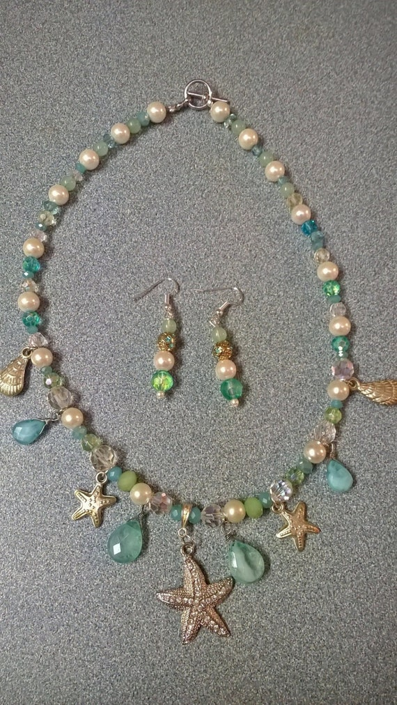 coastal beaded necklace in blue green and white with assorted