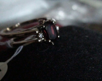 gold garnet and cz flip ring january birthstone