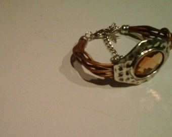 Boho chic braided leather cuff with facet glass charm Ibiza style  Gold leather lace bracelet