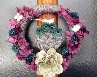 Yarn Winter Wreach with flowers and bird