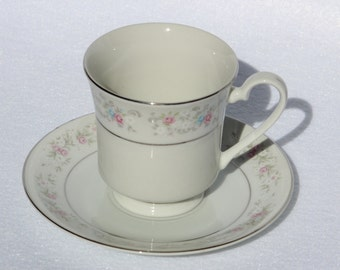 Tea Cup and Saucer by Dynasty Fine China