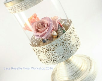 Preserved flower in artistic glass cylinder