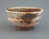 Teacup, wood-fired iron rich stoneware with crawling shino, local slip and natural ash glazes