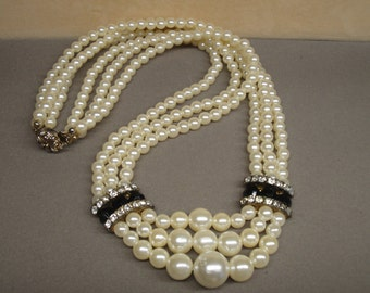 Vintage 3 strand faux white pearl necklace with black and clear rhinestone side accents, 24 inches to 27 inches, Floral back slide in clasp