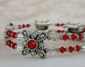 beaded memory wire bracelet, scarlet crystals embedded in metal castings, red Swarovski crystal memory wire bracelet, red Swarovski crystal