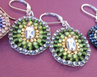 green and gold seed bead stitched earrings with sterling oval focals