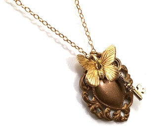 Romantic heart necklace with butterfly and key charms