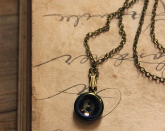 The Eye of Moriarty. Rustic Bohemian Black Iridescent Antique Glass Button Necklace.