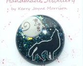 Howling wolf circular brooch with sparkling moon and glittery night sky