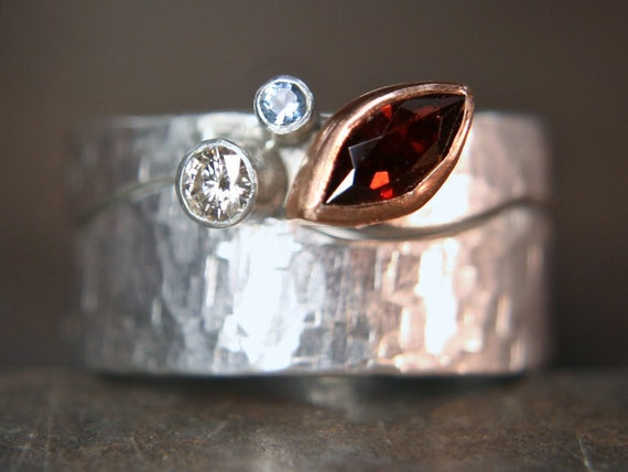 Recycled sterling silver and rose gold curvy stacking ring set. Fairtrade garnet, aquamarine and ethical lab grown moissanite. UK size P