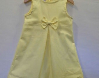 Yellow twill front pleat and bow sleeveless girls dress