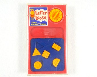 Retro Letter Loose Tomy Pocket Game from 1978
