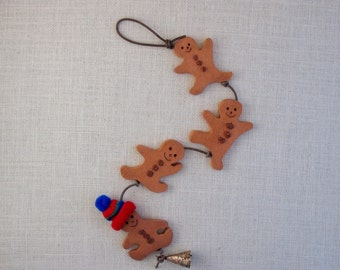 Ceramic Gingerbread Boys Wall Hanging (4) - Holiday-themed String of Four - Mini Knit Hat - Burlap Texture - Whimsical - Tumbling