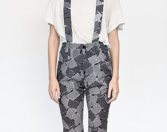 Black and white suspender pants