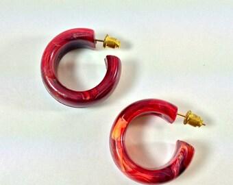 Red swirl hoop earrings