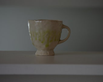 White Teacup with Green Drips
