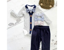 Newborn Baby Boy Coming Home Outfit Set up to 4 Items. Cardigan Bodysuit, Bow Tie Bodysuit, Navy Blue Pants & Knit Newsboy Hat. Holiday Set