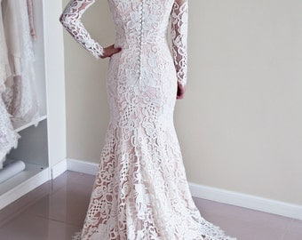 Lace Wedding Dress with Covered Back and Long Sleeves made of designer lace