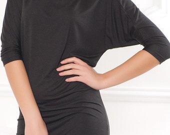 Dolman style. Black tunic.