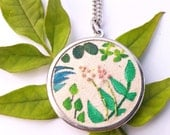 ON SALE Tiny Jungle Painting Necklace. Tiny Leaves and Flowers. Hand Stitched Necklace. Round Leaf Pendant. Hand Embroidered Flowers.