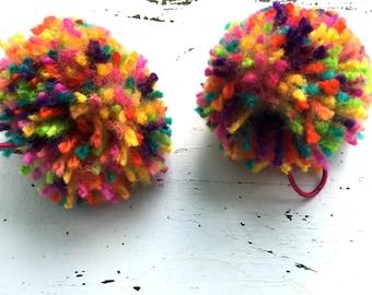 2 Multi colored pom pom hair ties