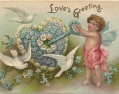 Cherub Turning Key in Heart Lock Covered in Forget-Me-Nots with White Doves Flying Vintage Postcard