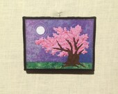 Cherry Tree in the Moonlight, 6x8 inch canvas, freehand applique fiber art, all recycled fabrics, sewn on a 1968 Singer, ready to hang