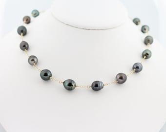 Tahitian pearl necklace, saltwater, black, dark, semi-baroque, circle, tin cup: Simply Adorned
