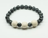 Snowflake Obsidian diffuser bracelet - Unisex - African hand-rolled clay bead, aromatherapy, yoga, chakra