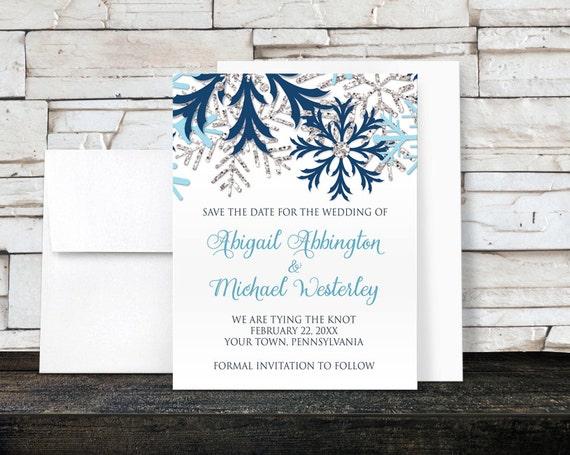 winter save the date cards blue silver snowflake design on white