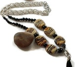 African Boho Ladies Beaded Necklace, Mahogany Swirl Beads with Leather Tassel.  Beautiful Gift for Mom or Graduate
