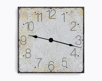 White wall clock with speckles.  Square design.