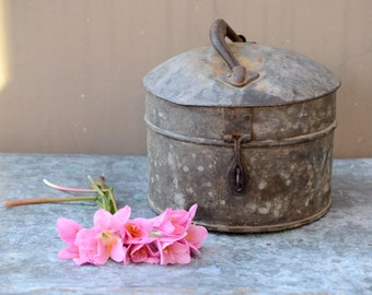 Old rustic round tin container lidded hinged and latched old country cottage decor Barn house