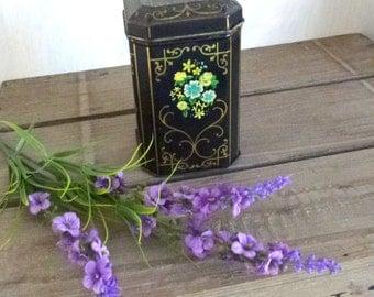 Antique black floral tin