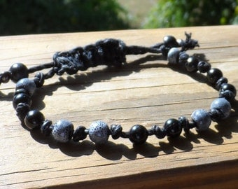 Black hemp knotted bracelet with denim and black porcelain beads and adjustable closure